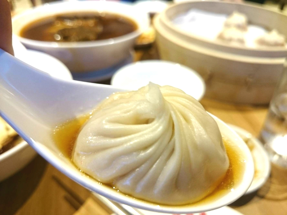 Pork Xiao Long Bao on a Chinese Soup Spoon
